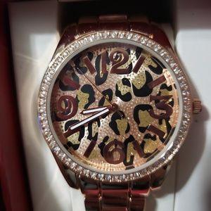 WOMEN'S Leopard gold/rhinestone accent link watch.